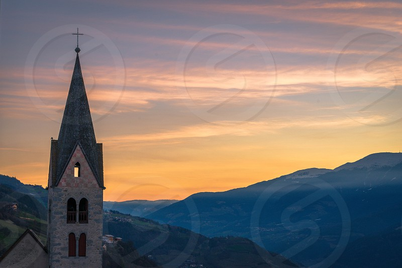 Belfry of the Parish Church in Villanders at Sunrise photo