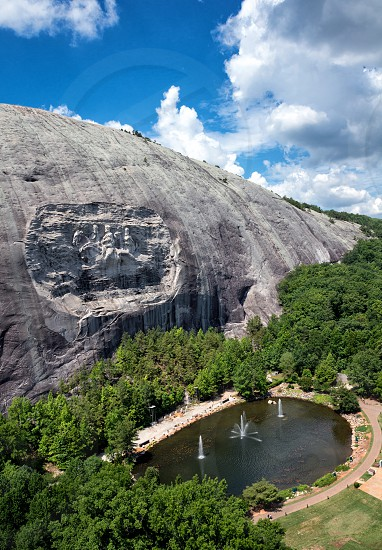 Aerial shot of Stone Mountain near Atlanta Georgia.  Stone Mountain is the largest exposed piece of granite in the world. It also features the largest bas-relief in the world. photo