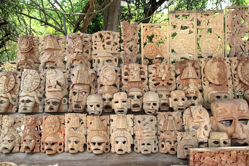Mayan wooden handcrafted mask in rows Mexico from indian culture photo
