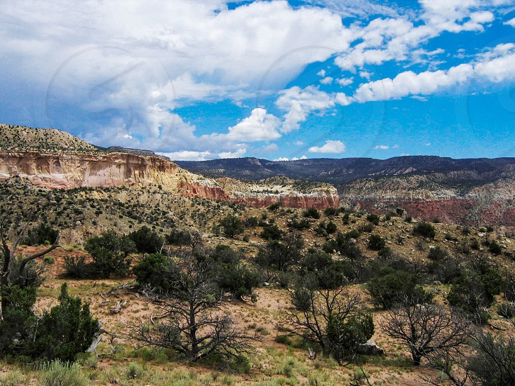 The dramatic southwestern desert landscape of Ghost Ranch New Mexico an hour northwest of Santa Fe made famous by Georgia O'Keeffe a landscape that offers hiking climbing camping and outdoor adventure. photo