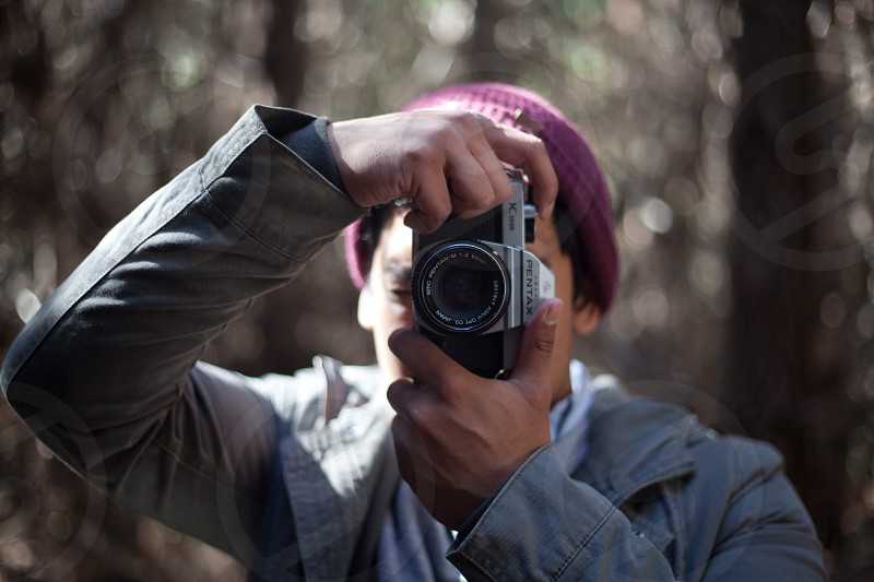 person holding black dslr camera photo