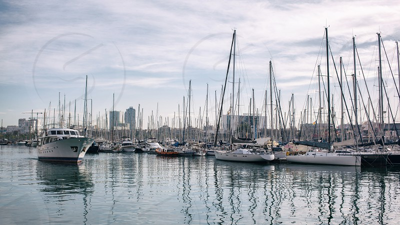 Yachts in the port Barcelona Sailboat harbor many beautiful moored sail yachts in the sea port modern water transport. Spain photo
