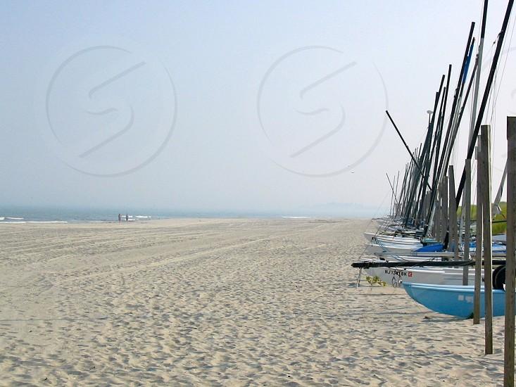 blue wooden row board on the seashore photo