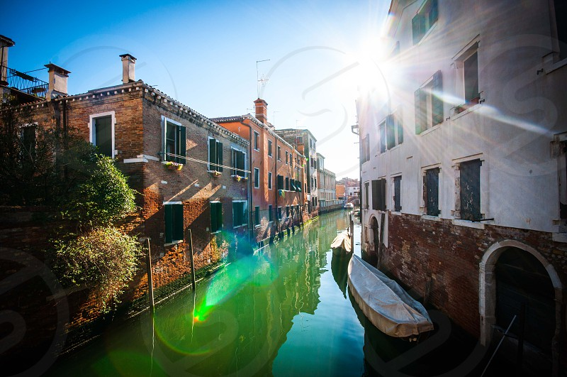 Venice canal lensflare photo