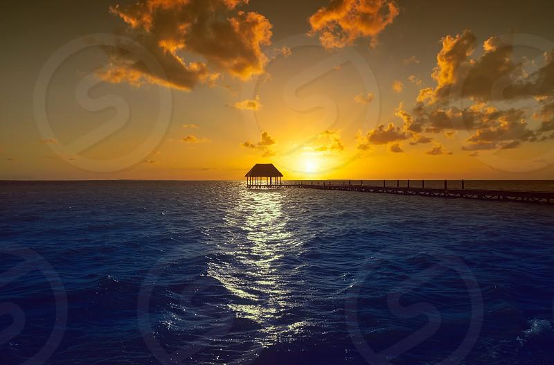 Holbox island sunset beach tropical hut pier in Mexico photo