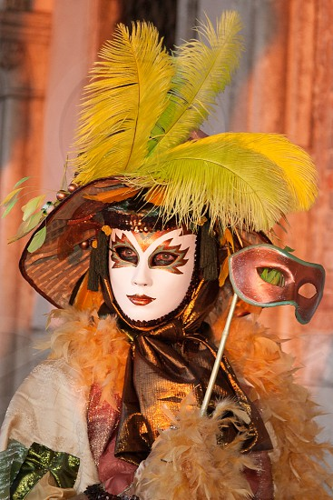 Model at sunrise during Carnivale in Venice wearing Marsala color photo