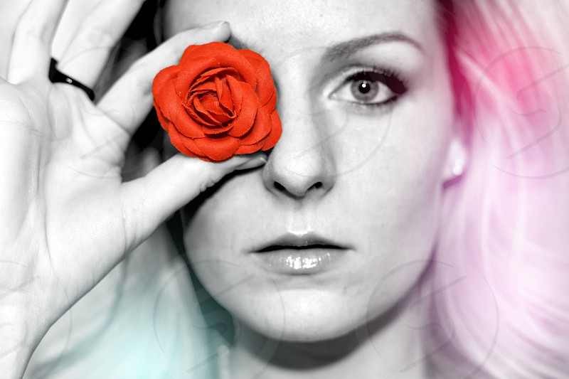 red rose on right eyes of a woman photo