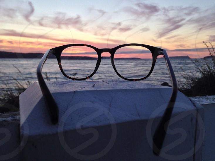 black framed eyeglasses on top of gray stone photo