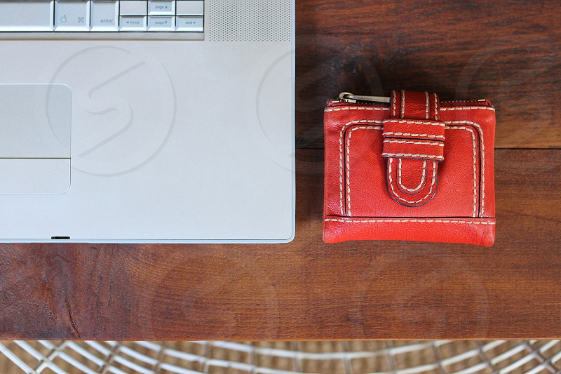 Laptop with red leather wallet photo
