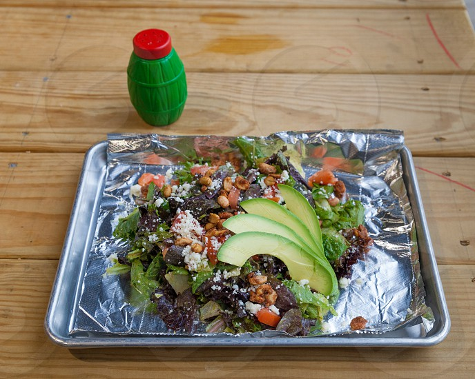 sliced avocado on stainless steel rectangular tray photo