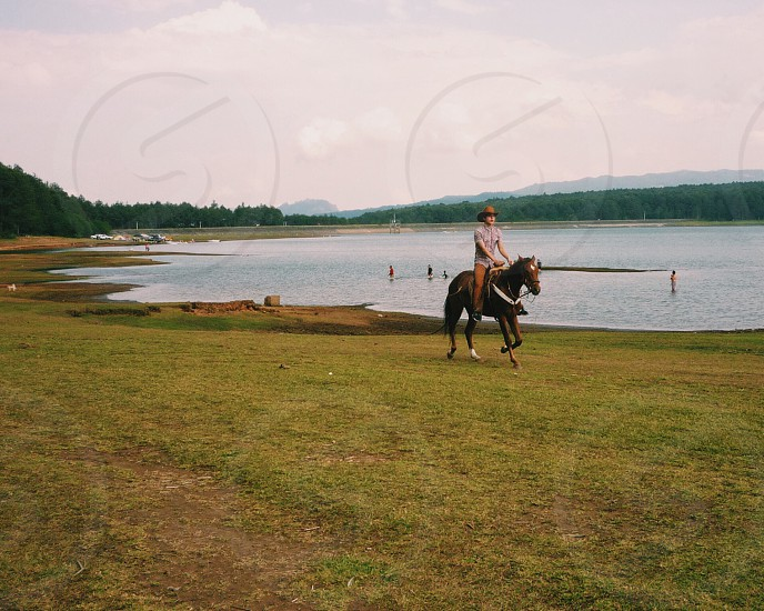 Ride a horse lake happy day photo