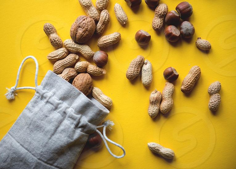Environmentally friendly fabric bag with peanuts and hazelnuts  photo