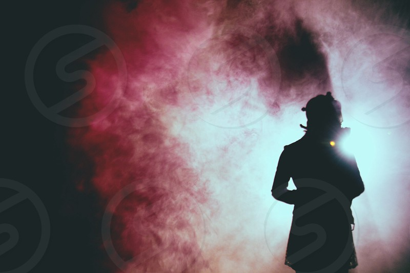 silhouette in brown smoke photography photo