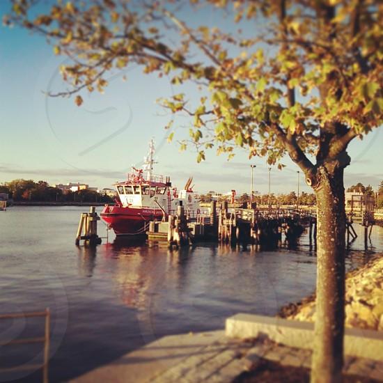 Maintenance boat docked in cove East Boston MA photo
