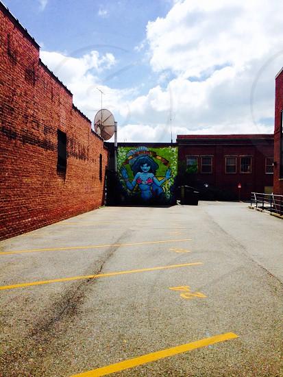 Art graffiti mermaid parking lot brick photo