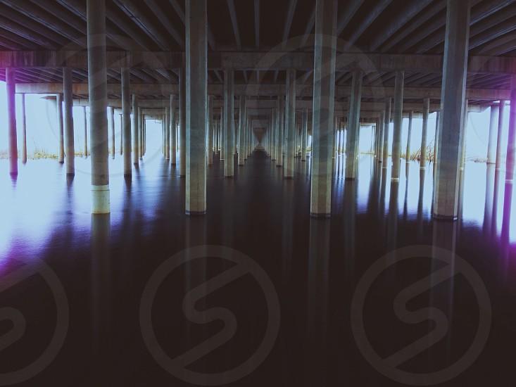 white pier pillars in ocean photo