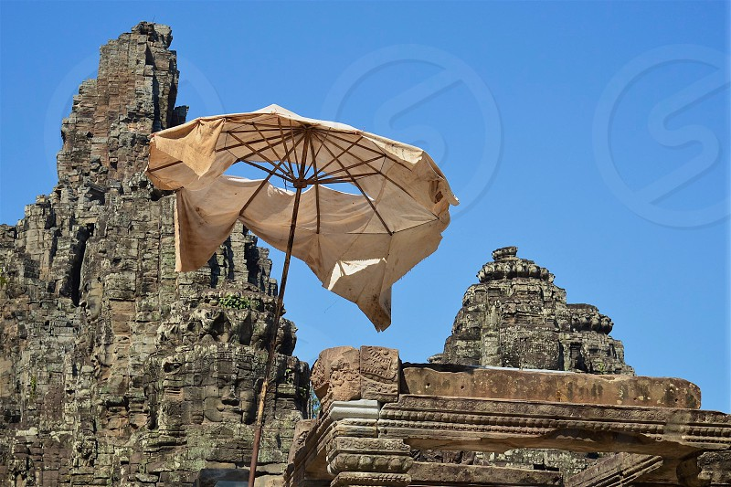 Weathered umbrellas at Angkor Wat Temples in Cambodia photo