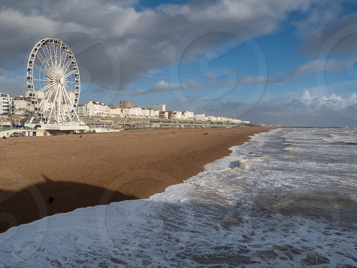 BRIGHTON SUSSEX/UK - FEBRUARY 15 : Brighton after the storm in Sussex on February 15 2014. Unidentified people photo