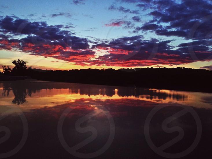 Fierce sunset reflected  photo