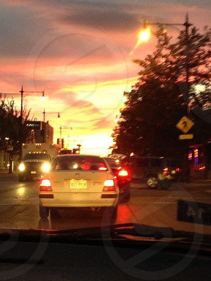 Orange sunset and traffic in the city. photo