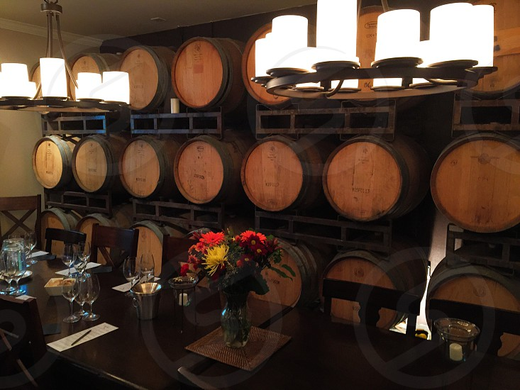 wood barrels on wall behind dining table photo