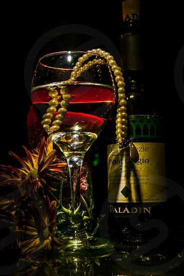 Beverage wine glass abstract reflections revenge blood red bottle pearls jewelry  photo