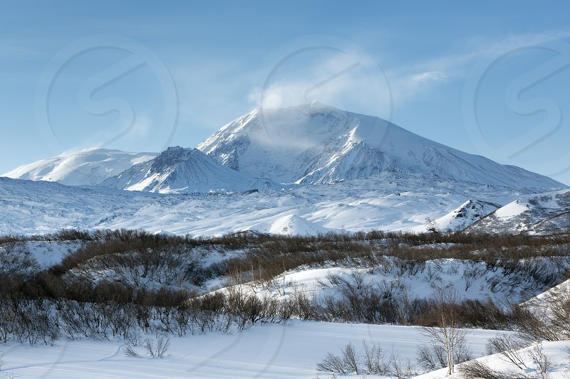 Beautiful winter volcanic landscape of Kamchatka Peninsula: scenic view of the Krestovsky Volcano. Eurasia Russian Far East Kamchatsky Krai Klyuchevskaya group of volcanoes. photo
