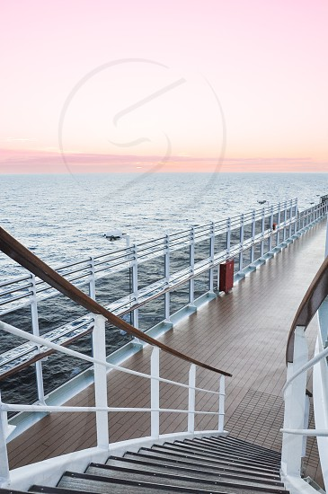 Luxury cruise ship deck at sunset photo