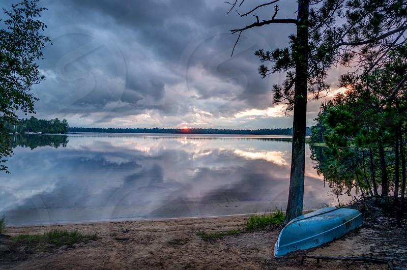 blue canoe on the ground photo