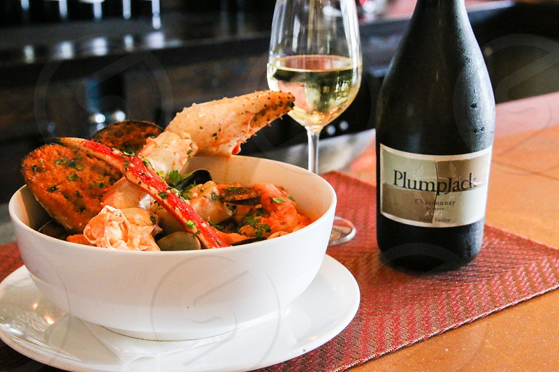 Cioppino and Plumpjack wine - horizontal photo