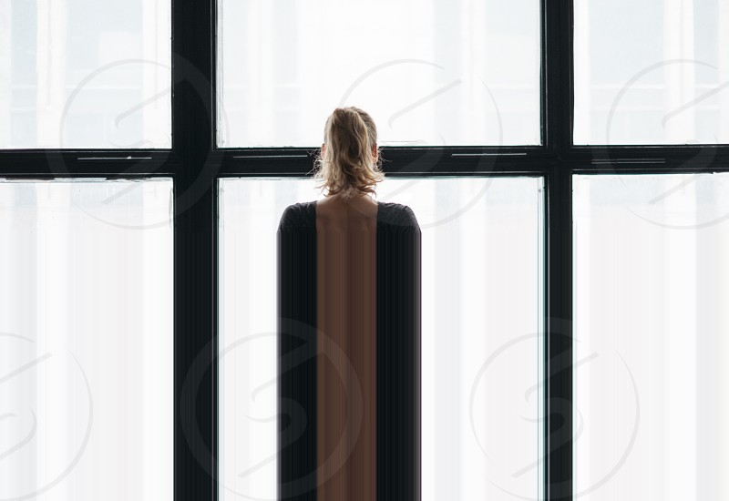 female woman doing yoga in the loft photo