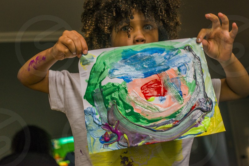 boy holding water color artwork photo