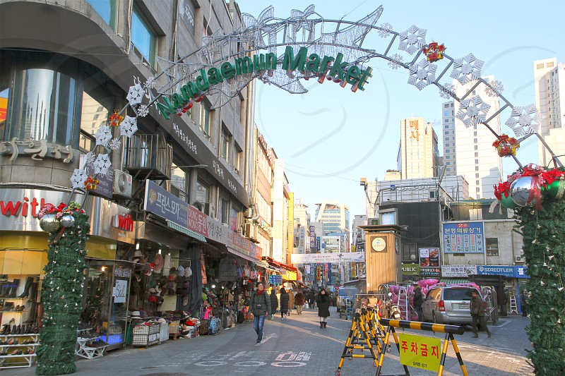 Namdaemun market stalls in Seoul South Korea with a mix of products from clothes to fruits and restaurants. photo