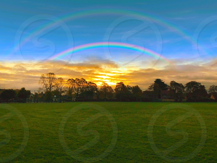 Eveningskyrainbowfieldlandscape photo