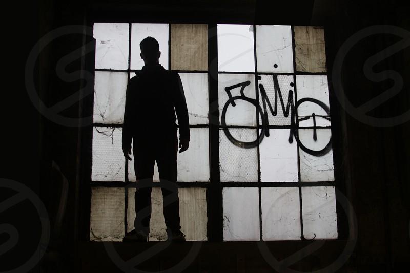 man standing near window photo