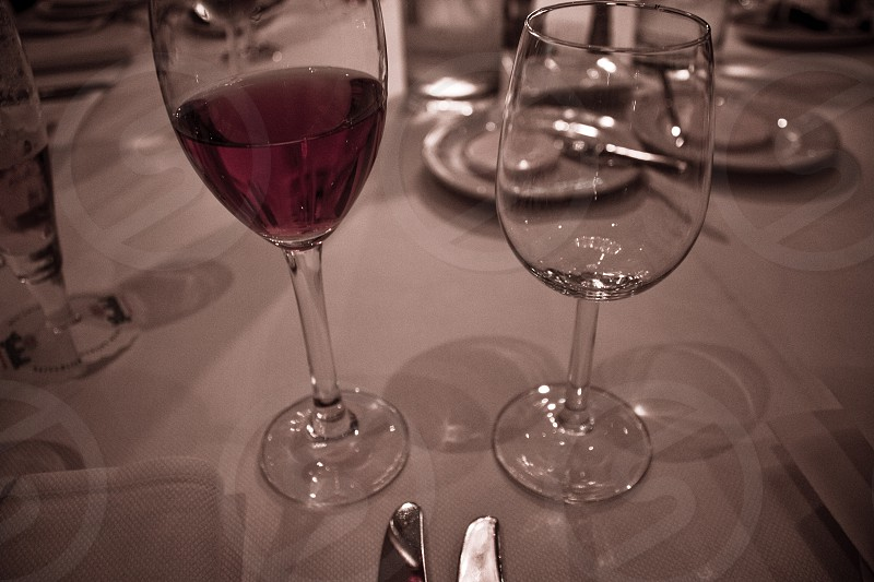 Glasses and rose ready for dinner. photo