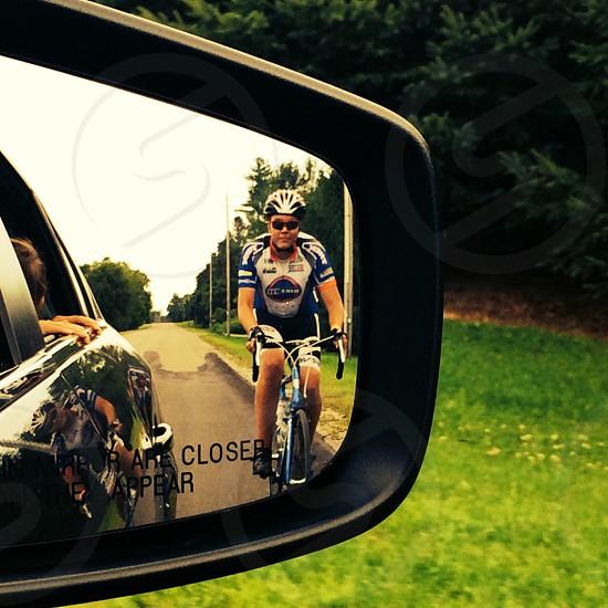 man riding road bike photo