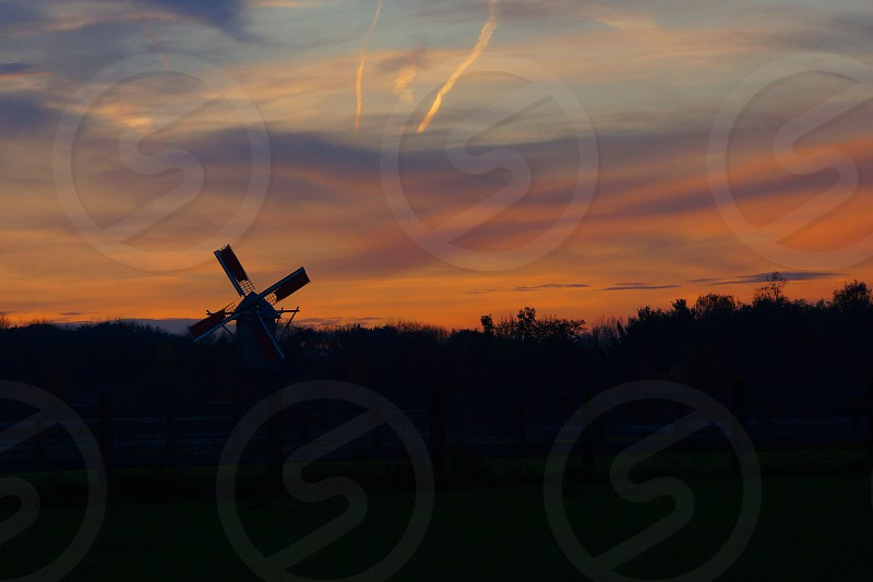 Evening view of a windmill in my beloved Flanders. Gives me peace of mind.   photo