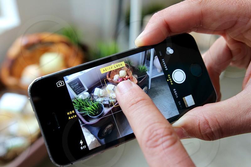 iPhone technology camera taking photo indoor farmer's market  photo