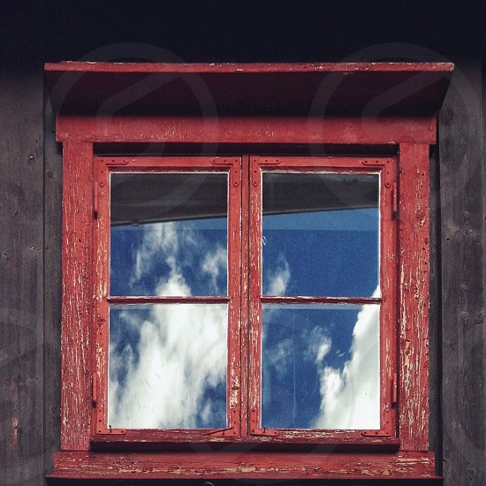 red wooden framed clear glass window photo