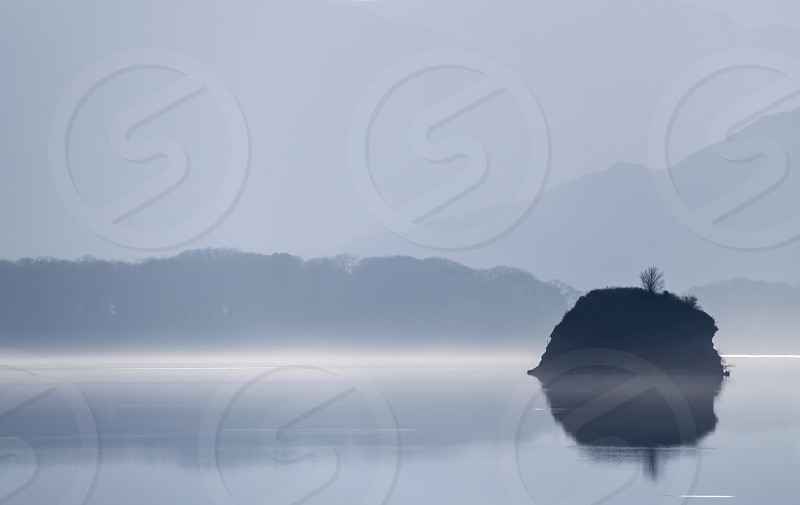 mountains and ocean covered with fogs photo