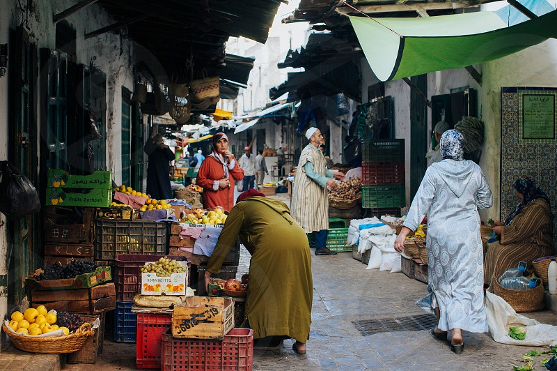 morocco moroccan women market street market selling fruit market street in morocco women fruit colorful tetuan photo