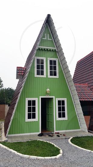 green adn white triangular shaped house photo