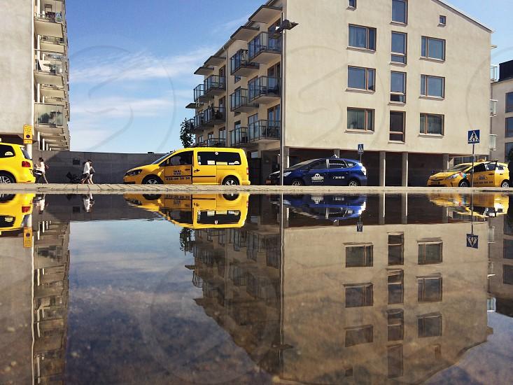 yellow sports utility vehicle near blue sports utility vehicle photo