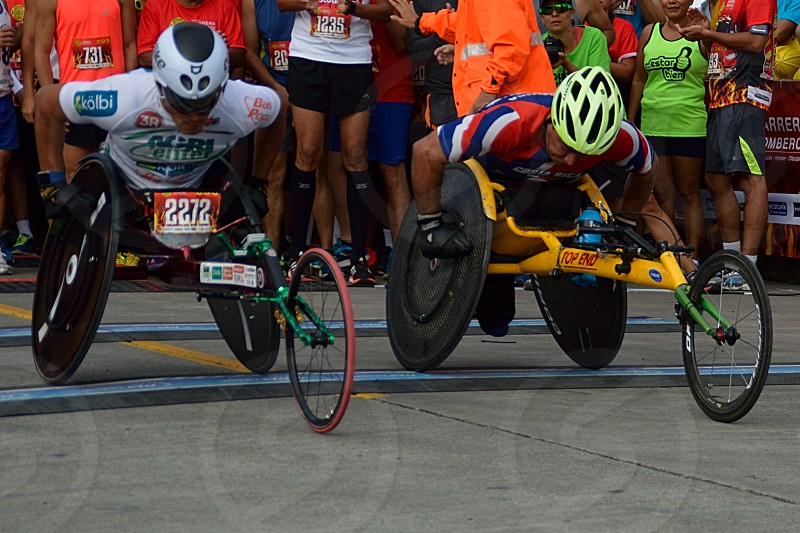 two disabled men racing with trike photo