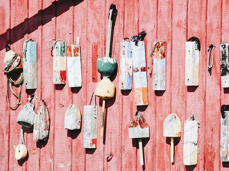 Vibrant red buoys New England House barn side water beach harbor boathouse boats bay seaside sea charm colorful summer old photo