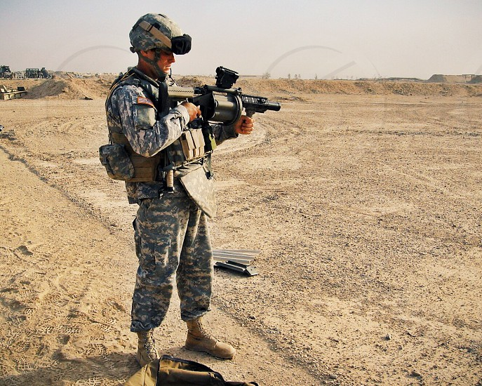Army soldier shooting grenade launcher photo