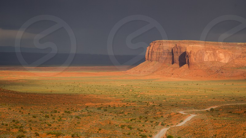Glorious Light- The valley seems to nearly glow as the sunsets light bathes the area with a golden hue. (Monument Valley Arizona)  photo