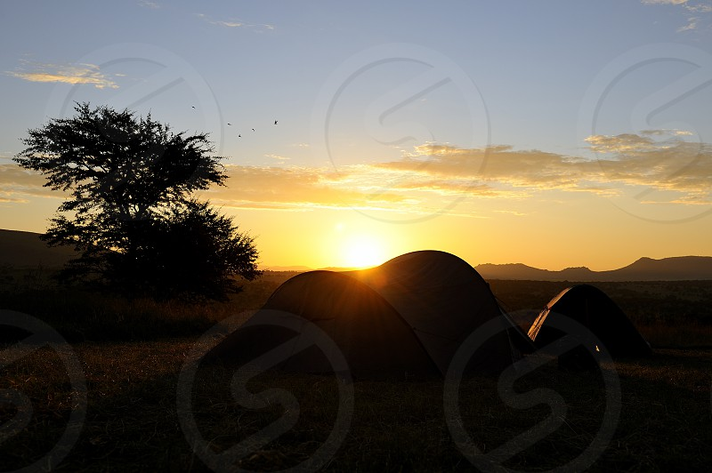 Sunrise over tents in Serengeti National Park Tanzania photo