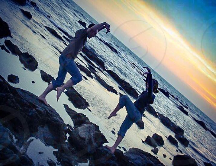 Balancing on Rocks at Sunset photo